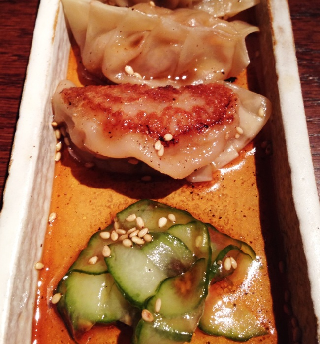 Beef, ginger and sesame Gyoza and pickled cucumber
