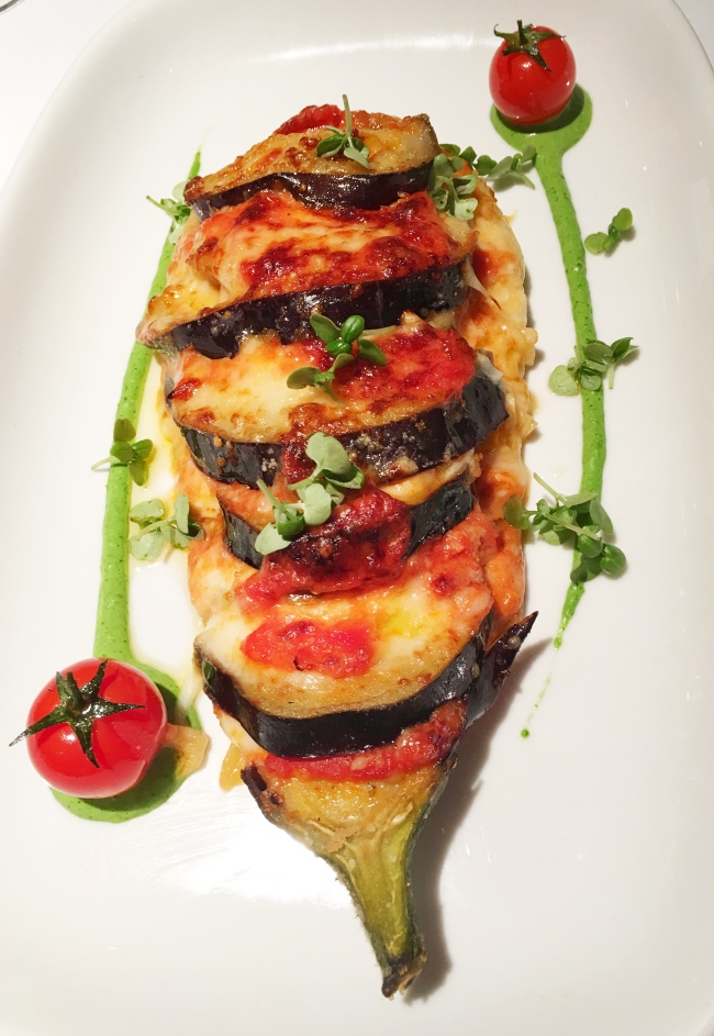 A starter portion of melanzane parmigiana. You won't go hungry.